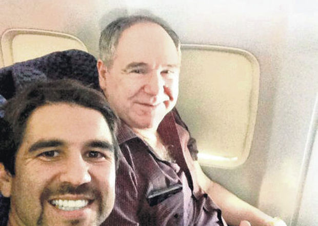 Abdala Bucaram Jr. next to his father.