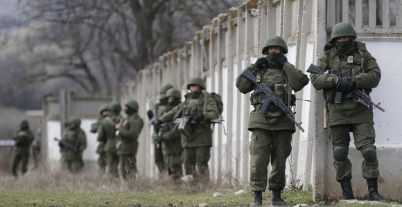 Russian soldiers watch over a base at Crimea.