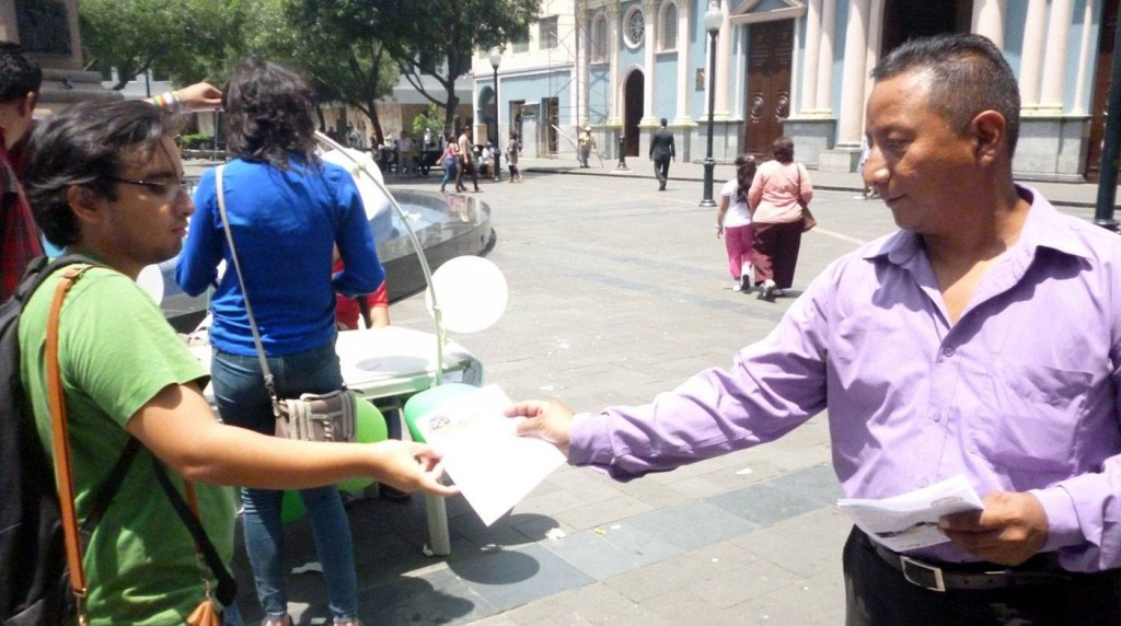 A teacher giving a pamphlet to a student.