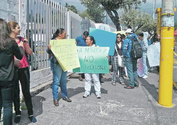 Members of the environmental group protest outside the signature verification centre.
