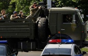 A truck with pro-Russian militia heads to Donetsk airport. Photo: REUTERS