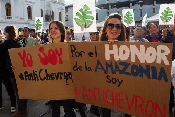 People at the Plaza del Teatro in Quito holding banners.