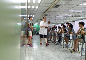 A voter (C) walks past volunteers at a polling station in Hong Kong o
