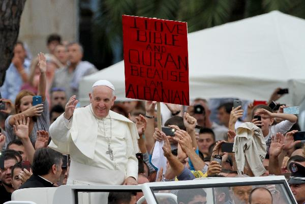 Pope Francis is greeted  as he arrives to celebrate a mass at Mother Teresa square in central Tirana.