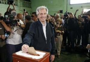 Uruguayan presidential candidate for the ruling Frente Amplio party Tabare Vasquez casts his vote in a polling station in Montevideo