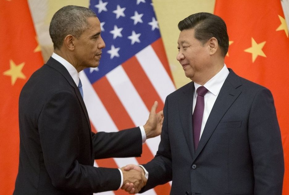 US President Barack Obama, along with Xi Jinping, China's president, after announcing a deal to curb climate change. AP
